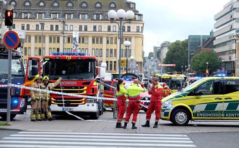 A photo taken from the instagram account of BernatMajo shows police officers and rescuers standing in a street in the Finnish city of Turku where several people were stabbed on August 18, 2017 (AFP Photo/Bernat Majo)