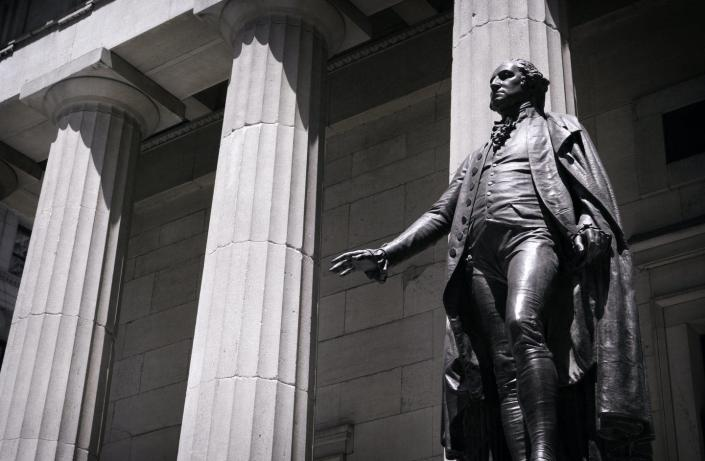 "<span class=""caption"">Statue of George Washington in front of Federal Hall in New York City.</span> <span class=""attribution""><a class=""link rapid-noclick-resp"" href=""https://www.gettyimages.com/detail/photo/george-wahington-statue-royalty-free-image/172154583?adppopup=true"" rel=""nofollow noopener"" target=""_blank"" data-ylk=""slk:Getty Images"">Getty Images</a></span>"