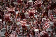 Members of the Viradouro samba school perform during the first night of Rio's carnival parade at the Sambadrome