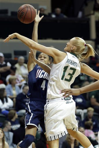 South Florida guard Inga Orekhova (13) blocks a shot by Connecticut guard Moriah Jefferson (4) during the first half of an NCAA college basketball game, Saturday, March 2, 2013, in Tampa, Fla. (AP Photo/Chris O'Meara)