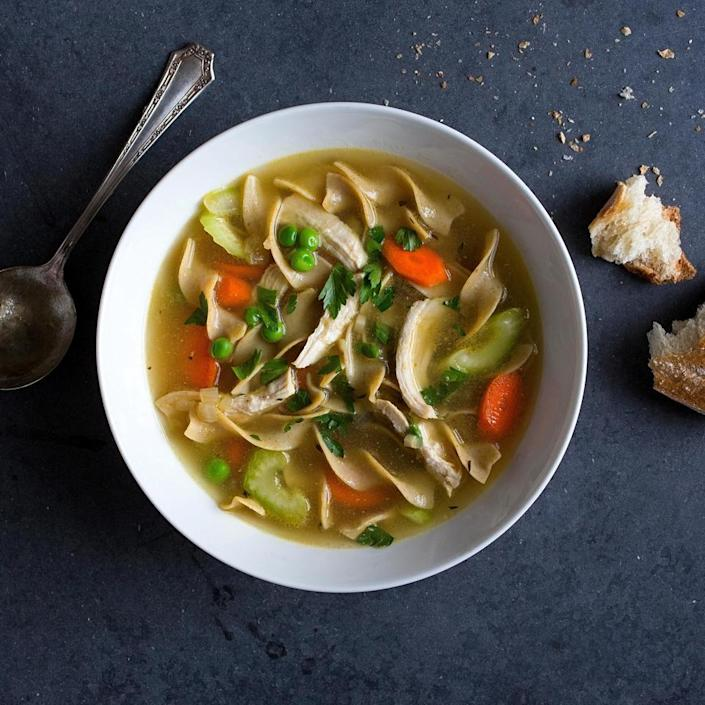 <p>Classic chicken noodle soup gets a healthy upgrade with low-sodium chicken broth, whole-wheat egg noodles and tons of vegetables. To get a homemade stock flavor using store-bought broth, we simmer bone-in chicken breasts in the broth before adding the rest of the soup ingredients. But you're short on time, feel free to use pre-cooked chicken and start the recipe at step 2.</p>
