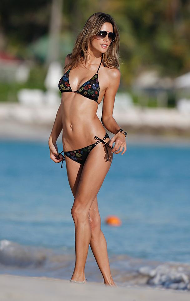 """Is it just us, or does Brazilian babe Alessandra Ambrosio somewhat resemble supermodel Cindy Crawford in her big sunglasses and itty-bitty bikini? <a href=""""http://www.splashnewsonline.com"""" target=""""new"""">Splash News</a> - January 23, 2010"""