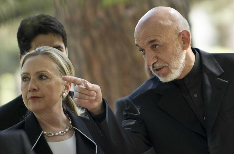 "US Secretary of State Hillary Rodham Clinton, left, walks with President of Afghanistan Hamid Karzai to a press conference at the Presidential Palace in Kabul Saturday July 7, 2012. The Obama administration on Saturday declared Afghanistan the United States' newest ""major non-NATO ally,"" an action designed to facilitate close defense cooperation after U.S. combat troops withdraw from the country in 2014 and as a political statement of support for Afghanistan's long-term stability. (AP Photo//Brendan Smialowski, Pool)"