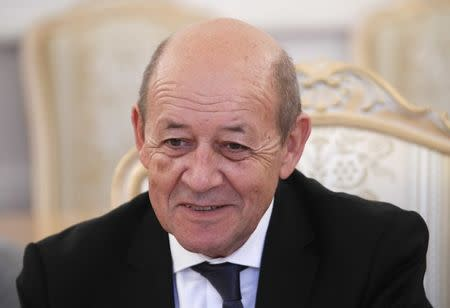 French Foreign Minister Le Drian attends a meeting with his Russian counterpart Lavrov in Moscow
