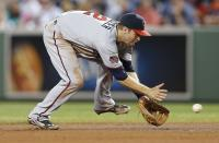 Minnesota Twins' Brian Dozier fields the infield single by Boston Red Sox's Xander Bogaerts during the sixth inning of a baseball game in Boston, Monday, June 16, 2014. (AP Photo/Michael Dwyer)