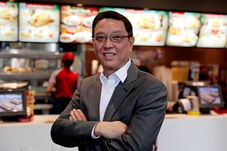 Ernesto Tanmantiong, President and CEO of Philippine national champion Jollibee Foods Corp., poses inside a Jollibee branch in Pasig City