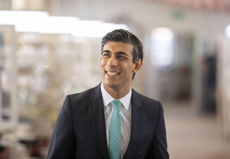 Britain's Chancellor Rishi Sunak smiles, during a visit to the Emma Bridgewater pottery in Stoke-on-Trent, Staffordshire, England, Monday, Sept. 14, 2020. Employees at the factory are now back at work after being furloughed due to the coronavirus outbreak. (Andrew Fox/Pool Photo via AP)