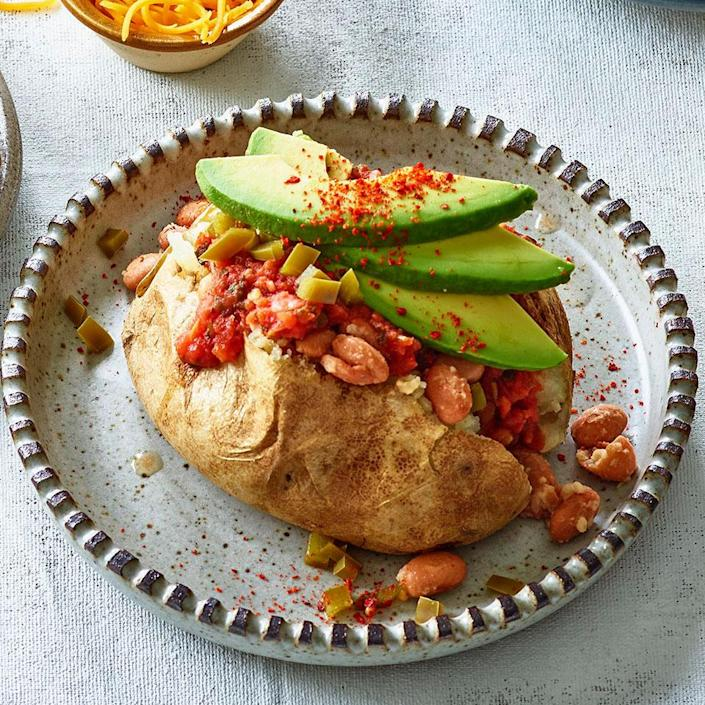 <p>Taco night meets baked potato night with this simple recipe for loaded baked potatoes with salsa, beans and avocado. This easy, healthy family dinner comes together with just 10 minutes of active time, so you can make it on even the busiest of weeknights. This recipe is just as delicious with sweet potatoes in place of russets.</p>