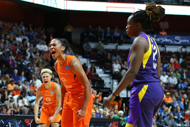"<a class=""link rapid-noclick-resp"" href=""/wnba/players/5190/"" data-ylk=""slk:Alyssa Thomas"">Alyssa Thomas</a>, middle, and <a class=""link rapid-noclick-resp"" href=""/wnba/players/5618/"" data-ylk=""slk:Courtney Williams"">Courtney Williams</a> are one win away from a finals berth for the Connecticut Sun. (Photo by M. Anthony Nesmith/Icon Sportswire via Getty Images)"
