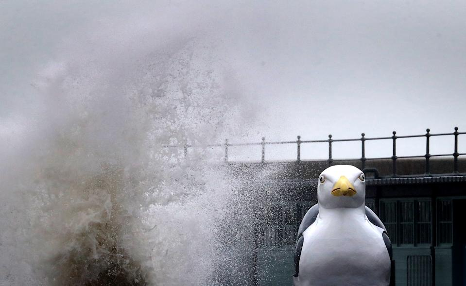 Waves crash over a model of a seagull as they hit the harbour wall in Folkestone, Kent. Parts of the UK are preparing to be lashed by heavy rain and high winds as Storm Alex heralds the arrival of a stretch of bad weather over the weekend.