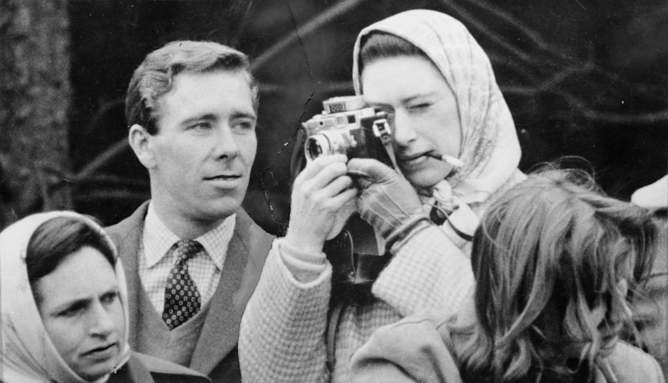 Professional photographer Antony Armstrong-Jones, the Earl of Snowdon, watches critically as his fiancee Princess Margaret (1930 - 2002) takes a snap at the Badminton Horse Trials.   (Photo by Keystone/Getty Images)