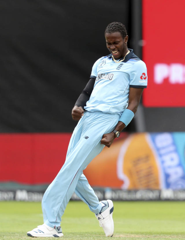 England's bowler Jofra Archer celebrates after taking a wicket of Australia's Glenn Maxwell during the Cricket World Cup semi-final match between Australia and England at Edgbaston in Birmingham, England, Thursday, July 11, 2019. (AP Photo/Rui Vieira)