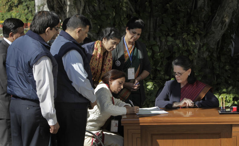India's ruling Congress party president Sonia Gandhi, right, is enumerated by census officials during the second phase of India census in New Delhi, India, Wednesday, Feb. 9, 2011. The second phase of census called the population enumeration will be conducted simultaneously all over India from Feb.  to February 9 through 28.(AP Photo/Manish Swarup)