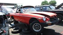 """<p><a href=""""https://www.aronline.co.uk/cars/mg-cars/mgb/ado23-development-history/"""" rel=""""nofollow noopener"""" target=""""_blank"""" data-ylk=""""slk:The MGB"""" class=""""link rapid-noclick-resp"""">The MGB</a> sold so well in the United States that, as recently as 35 years ago, you'd see plenty of them mixed into ordinary commuter traffic here. It was a sturdy little <a class=""""link rapid-noclick-resp"""" href=""""https://www.autoblog.com/performance/"""" data-ylk=""""slk:sports car"""">sports car</a>, with a suspension design out of the 1940s and a primitive-but-tough pushrod engine, and it blew away its <a href=""""https://www.autoblog.com/2016/08/30/1980-fiat-124-spider-automatic-junkyard-gem/"""" data-ylk=""""slk:Fiat 124 Sport Spider"""" class=""""link rapid-noclick-resp"""">Fiat 124 Sport Spider</a> rival in the reliability department. Here's a final-year-of-production '80 in a Denver-area self-service wrecking yard. <a href=""""https://www.autoblog.com/2018/09/13/junkyard-gem-1980-mg-mgb/"""" data-ylk=""""slk:Read more"""" class=""""link rapid-noclick-resp""""><em>Read more</em></a>.</p>"""