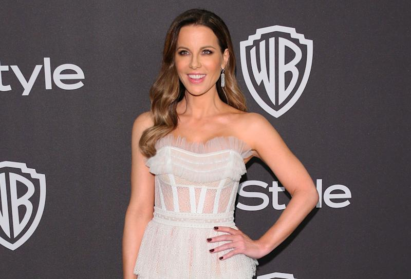 Kate Beckinsale poses at a press event
