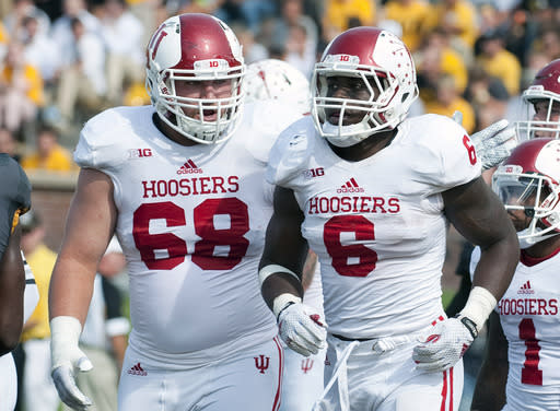 Indiana's David Kaminski, left, congratulates teammate Tevin Coleman after Coleman scored a touchdown during the first quarter of an NCAA college football game against Missouri, Saturday, Sept. 20, 2014, in Columbia, Mo. (AP Photo/L.G. Patterson)