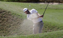 Dustin Johnson plays a shot from a bunker on the third hole during a practice round at the Dell Technologies Match Play golf tournament at the Austin Country Club, Tuesday, March 20, 2018, in Austin, Texas. (AP Photo/Eric Gay)