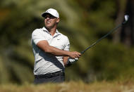 Brooks Koepka watches his second shot on the fifth hole during the first round of the Genesis Invitational golf tournament at Riviera Country Club, Thursday, Feb. 18, 2021, in the Pacific Palisades area of Los Angeles. (AP Photo/Ryan Kang)