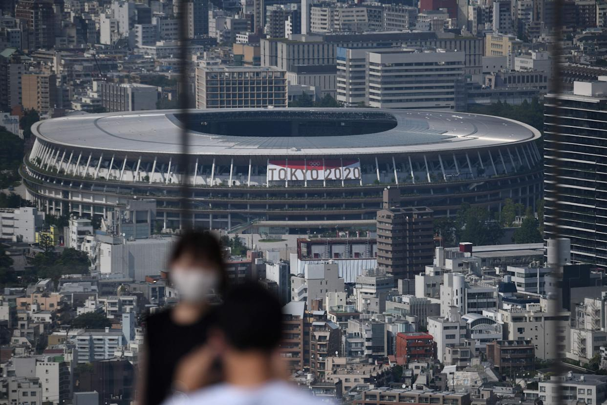 A general view shows the National Stadium (C), the main venue for the 2020 Olympic and Paralympic Games in Tokyo on June 21, 2021. (Photo by Kazuhiro NOGI / AFP) (Photo by KAZUHIRO NOGI/AFP via Getty Images)