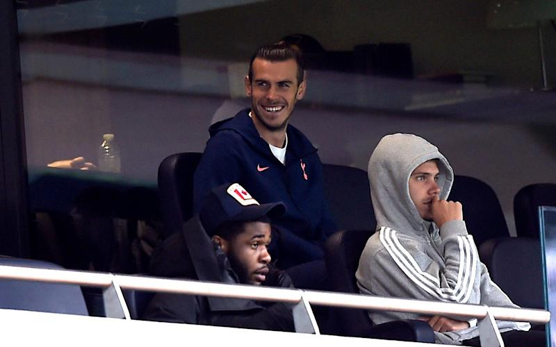 Tottenham Hotspur's Gareth Bale watches the match from the stands during the Premier League match at Tottenham Hotspur Stadium, London. - PA