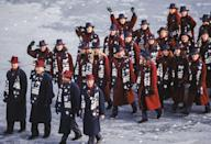 <p>Team USA was dressed to the nines in France, showing off long burgundy and navy overcoats, beautifully detailed scarves, and matching hats. </p>