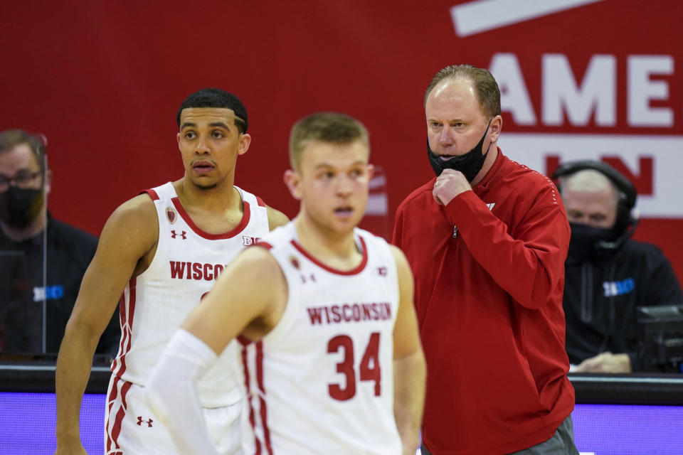 FILE - Wisconsin coach Greg Gard talks with D'Mitrik Trice, left, and Brad Davison during the second half of the team's NCAA college basketball game against Iowa in Madison, Wisc., in this Thursday, Feb. 18, 2021, file photo. Wisconsin's seniors were openly critical of coach Greg Gard during a late-season team meeting that was secretly recorded and later sent to a newspaper. The Wisconsin State Journal says it received a 37-minute audio file this week of a Feb. 19 team meeting that included seven senior players, Gard and three assistant coaches. The newspaper said it received the recording from an anonymous email account and that it included only a portion of the actual meeting.(AP Photo/Andy Manis, File)