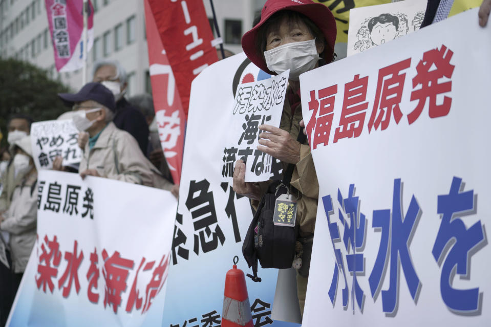 "People protest against government's decision to start releasing massive amounts of treated radioactive water from the wrecked Fukushima nuclear plant into the sea, during a rally outside the prime minister's office in Tokyo Tuesday, April 13, 2021. The decision, long speculated but delayed for years due to safety concerns and protests, came at a meeting of Cabinet ministers who endorsed the ocean release as the best option. Signs mean ""Don't release radioactive water into the sea."" (AP Photo/Eugene Hoshiko)"