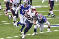 New England Patriots' James White (28) rushes past Buffalo Bills' A.J. Klein (54) and Trent Murphy (93) during the first half of an NFL football game Sunday, Nov. 1, 2020, in Orchard Park, N.Y. (AP Photo/Adrian Kraus)