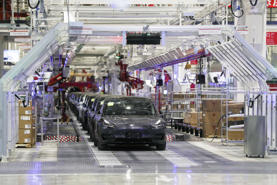 In this photo released by China's Xinhua News Agency, Tesla vehicles are seen on an assembly line at Tesla's gigafactory in Shanghai, Tuesday, Jan. 7, 2020. Tesla's Shanghai factory delivered its first cars to customers Monday, and chief executive Elon Musk said the electric automaker plans to set up a design center in China to create a model for worldwide sales. (Ding Ting/Xinhua via AP)