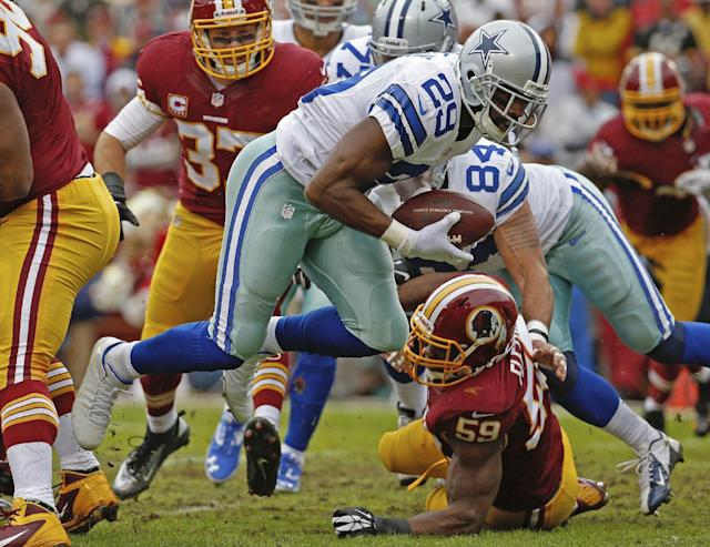 Dallas Cowboys running back DeMarco Murray (29) carries the ball into the end zone past Washington Redskins inside linebacker London Fletcher (59) for a touchdown during the first half of an NFL football game in Landover, Md., Sunday, Dec. 22, 2013. (AP Photo/Alex Brandon)