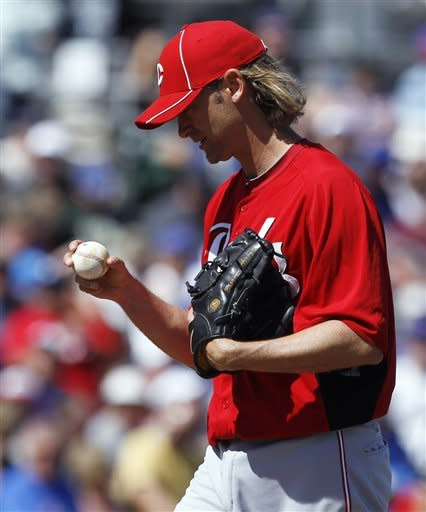 Cincinnati Reds starting pitcher Bronson Arroyo stares at the ball after giving up a home run to Chicago Cubs' Alfonso Soriano during the second inning of a spring training baseball game in Mesa, Ariz., Monday, March 12, 2012. (AP Photo/Chris Carlson)