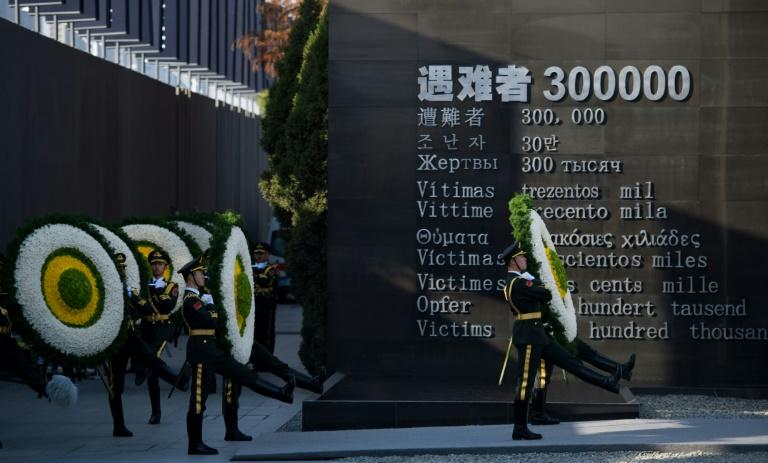 Soldiers of the People's Liberation Army attend a memorial ceremony at the Memorial Hall of the Victims in Nanjing Massacre, in Nanjing city on  December 13, 2014
