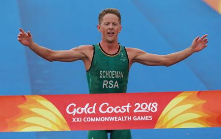 Triathlon - Gold Coast 2018 Commonwealth Games - Men's Final - Southport Broadwater Parklands - Gold Coast, Australia - April 5, 2018 - Henri Schoeman of South Africa crosses the finish line in first place. REUTERS/Athit Perawongmetha