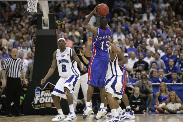 FILE - In this Monday, April 7, 2008, file photo, Kansas' Mario Chalmers shoots a three pointer to take the game in to overtime against Memphis during the championship game at the NCAA college basketball Final Four in San Antonio. Kansas defeated Memphis 75-68 in overtime. (AP Photo/Mark Humphrey, File)