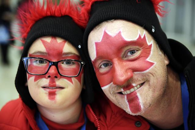 Canadian fans pose for a picture prior to the start of the men's 500-meter speedskating race at the Adler Arena Skating Center at the 2014 Winter Olympics, Monday, Feb. 10, 2014, in Sochi, Russia. (AP Photo/Matt Dunham)
