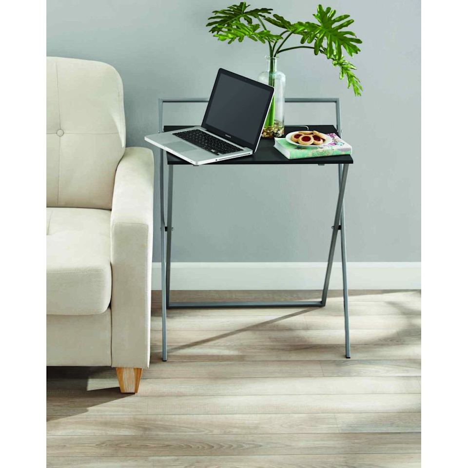"""<h2>Mainstays Metal And Wood Folding Table</h2><br><br><strong>Mainstays</strong> Metal And Wood Folding Table, $, available at <a href=""""https://go.skimresources.com/?id=30283X879131&url=https%3A%2F%2Fwww.bedbathandbeyond.com%2Fstore%2Fproduct%2Ffolding-desk-in-grey%2F5551516"""" rel=""""nofollow noopener"""" target=""""_blank"""" data-ylk=""""slk:Bed Bath & Beyond"""" class=""""link rapid-noclick-resp"""">Bed Bath & Beyond</a>"""