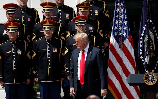 "U.S. President Donald Trump attends his ""celebration of America"" event with the United States Army Chorus on the South Lawn of the White House in Washington, U.S., June 5, 2018. The event was arranged after Trump canceled the planned visit of the Super Bowl champion Philadelphia Eagles to the White House. REUTERS/Kevin Lamarque"