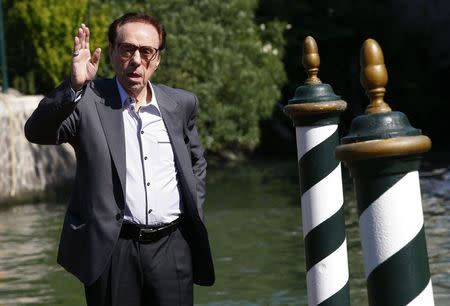 Director Peter Bogdanovich poses as he arrives to attend the 71st Venice Film Festival in Venice