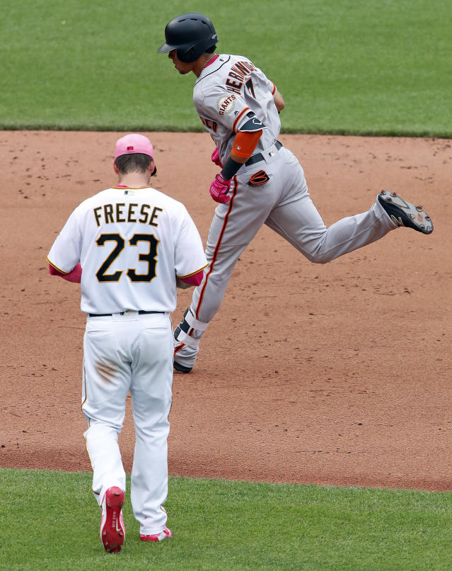 San Francisco Giants' Gorkys Hernandez, right, rounds third past Pittsburgh Pirates third baseman David Freese (23) after hitting a solo home run off Pirates starting pitcher Ivan Nova in the sixth inning of a baseball game in Pittsburgh, Sunday, May 13, 2018. (AP Photo/Gene J. Puskar)