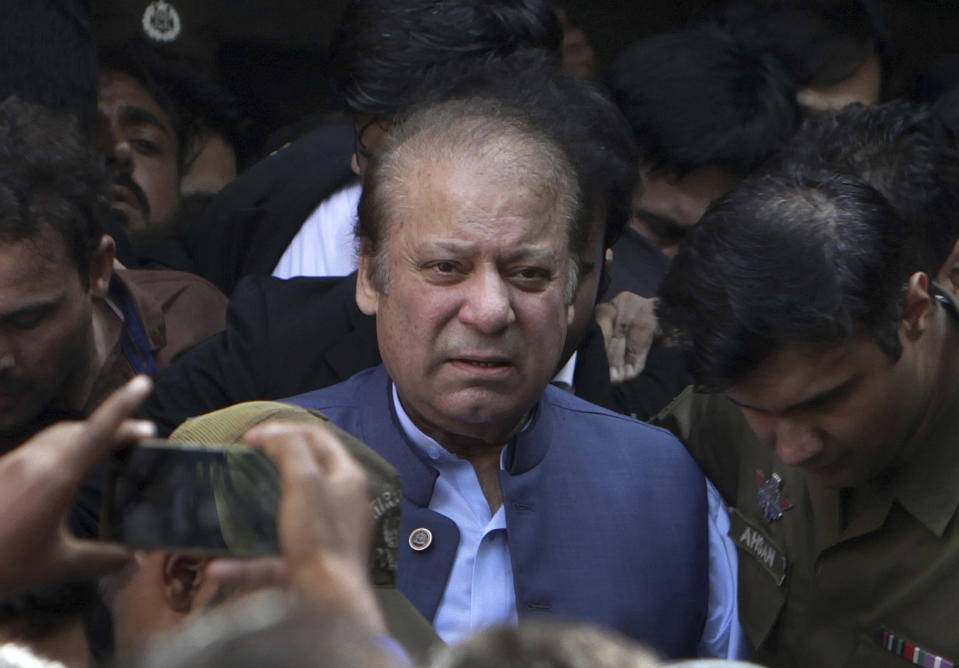 FILE - In this Oct. 8, 2018, file photo, former Pakistani Prime Minister Nawaz Sharif leaves after appearing in a court in Lahore, Pakistan. Pakistan's information minister said Friday, Dec. 18, 2020 that Islamabad has started a legal process to reach an extradition treaty with Britain that would pave the way for the U.K. to hand over Pakistan's former Prime Minister Sharif. (AP Photo/K.M. Chaudary, File)