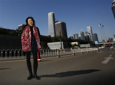 U.S. producer Janet Yang poses during an interview with Reuters in Beijing October 19, 2013. REUTERS/Kim Kyung-Hoon