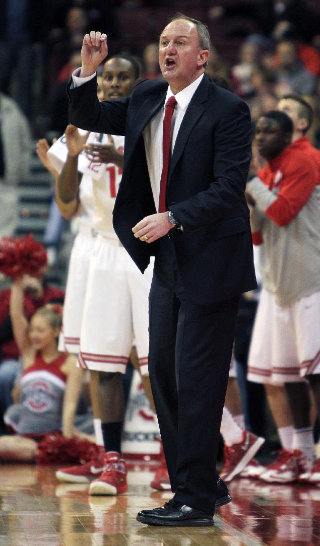 Ohio State head coach Thad Matta, right, instructs his team against Louisiana-Monroe during the first half of an NCAA college basketball game, Friday, Dec. 27, 2013, in Columbus, Ohio. Ohio State defeated Louisiana-Monroe 71-31. (AP Photo/Jay LaPrete)