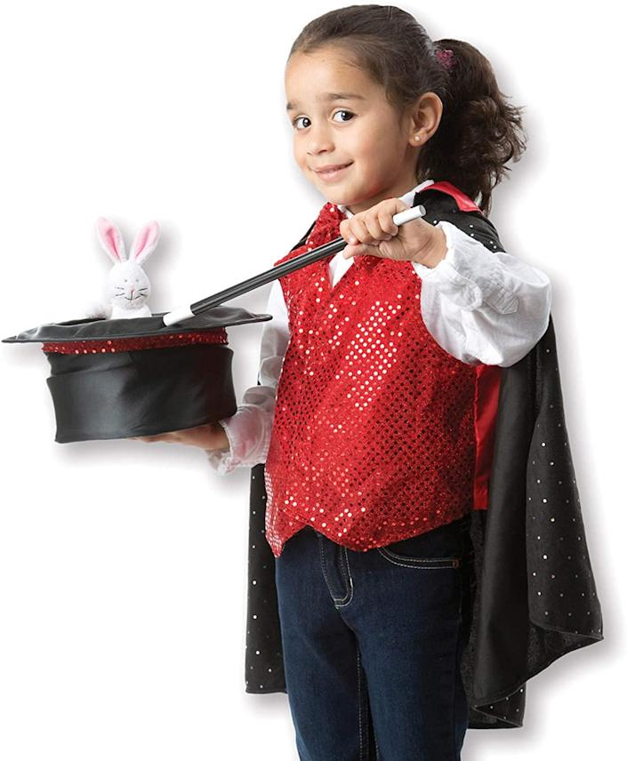 Kid in a magician costume