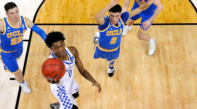 MEMPHIS - De'Aaron Fox stood in a hallway, smiled, and said he wished he could play for Kentucky again in an hour.