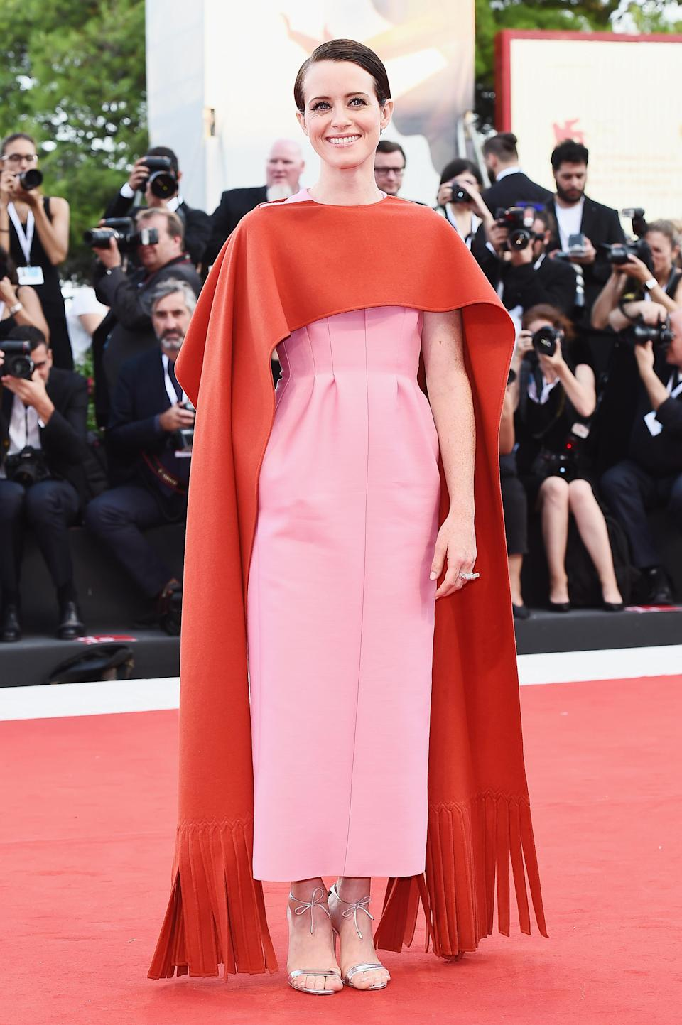 <p>'The Crown' actress wowed in a red and pink Valentino look. <em>[Photo: Getty]</em> </p>