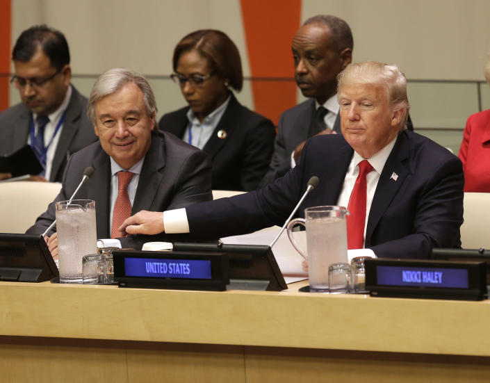 <p>United States President Donald Trump, right, pats United Nations Secretary-General Antonio Guterres' arm before a meeting during the United Nations General Assembly at U.N. headquarters, Monday, Sept. 18, 2017. (Photo: Seth Wenig/AP) </p>
