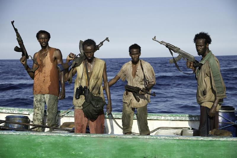 "This photo released by Sony - Columbia Pictures shows, from left, Faysal Ahmed, Barkhad Abdi, Barkhad Abdirahman, Mahat Ali, in a scene from the film, ""Captain Phillips,"" releasing in the US on Friday, Oct. 11, 2013. The amateur actors of Somali descent from Minneapolis made their film debut acting as Somali pirates alongside the two-time Academy Award winner, Tom Hanks. (AP Photo/Copyright Sony - Columbia Pictures, Jasin Boland)"