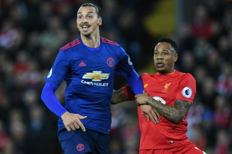 Liverpool's defender Nathaniel Clyne (R) marks Manchester United's striker Zlatan Ibrahimovic during the English Premier League football match between Liverpool and Manchester United at Anfield in Liverpool, north west England