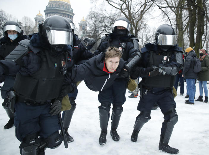 Police detain a man during a protest against the jailing of opposition leader Alexei Navalny in People gather in St.Petersburg, Russia, Saturday, Jan. 23, 2021. Russian police are arresting protesters demanding the release of top Russian opposition leader Alexei Navalny at demonstrations in the country's east and larger unsanctioned rallies are expected later Saturday in Moscow and other major cities. (AP Photo/Dmitri Lovetsky)