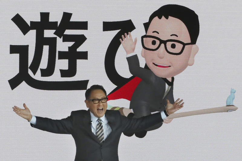 """Toyota Motor Corp. President Akio Toyoda speaks during Toyota's presentation of the media preview of the Tokyo Motor Show in Tokyo Wednesday, Oct. 23, 2019. The Japanese letters in the background read: """"Play."""" (AP Photo/Koji Sasahara)"""